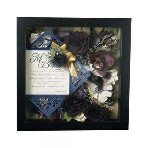 various colored dried preserved flowers in a shadow box wedding keepsake