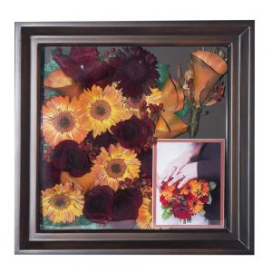 a beautiful shadowbox with her bouquet and his boutinierre and a lovely photo